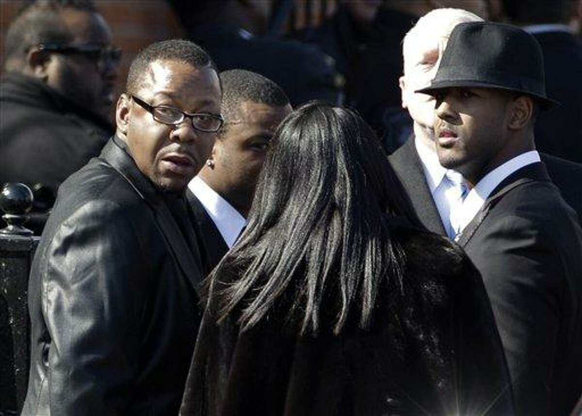 Singer Bobby Brown, left, is seen outside during the funeral of his ex-wife Whitney Houston at New Hope Baptist Church in Newark, N.J. Associated Press