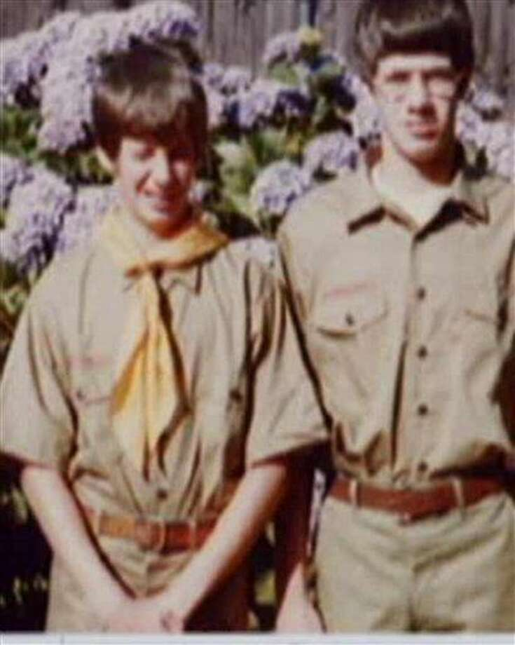 This family photo provided by Tom Stewart shows him, right, and his younger brother Matt, left, in their scout uniforms. The brothers settled out-of-court after suing the Boy Scouts in 2003 for abuse they had suffered at the hands of one of their Scoutmasters. The Stewarts are angry that the Boy Scouts of America have fought to keep confidential thousands of files the organization has kept since the early 1900s on suspected pedophiles within their ranks. The Stewarts say releasing the files decades ago would have helped stop pedophiles. (AP Photo/Courtesy Tom Stewart) Photo: AP / Tom Stewart