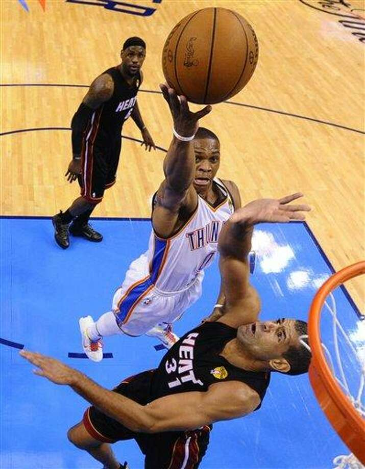 Oklahoma City Thunder point guard Russell Westbrook (0) shoots over Miami Heat small forward Shane Battier  as small forward LeBron James  ooks on during the first half at Game 2 of the NBA finals basketball series, Thursday, June 14, 2012, in Oklahoma City. (AP Photo/Larry W. Smith, Pool) Photo: ASSOCIATED PRESS / AP2012