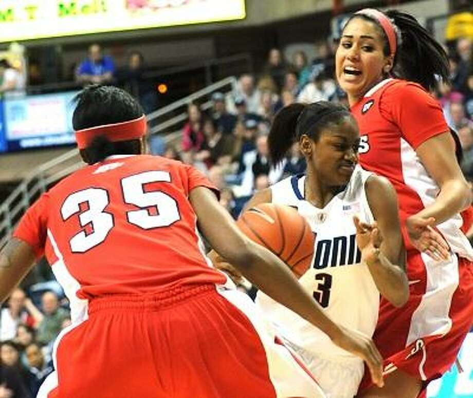 Connecticut's Tiffany Hayes pushes past St. John's Shenneika Smith, left, and Mary Nwachukwu for a shot in the first half of an NCAA women's college basketball game at Storrs, Conn., Saturday, Feb. 18, 2012. (AP Photo/Bob Child) Photo: ASSOCIATED PRESS / AP2012