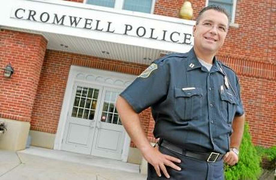 CATHERINE AVALONE/THE MIDDLETOWN PRESS Captain Edwin L. Kosinski, Jr. will retire Nov. 30 after a 23 year career at the Cromwell Police Department.
