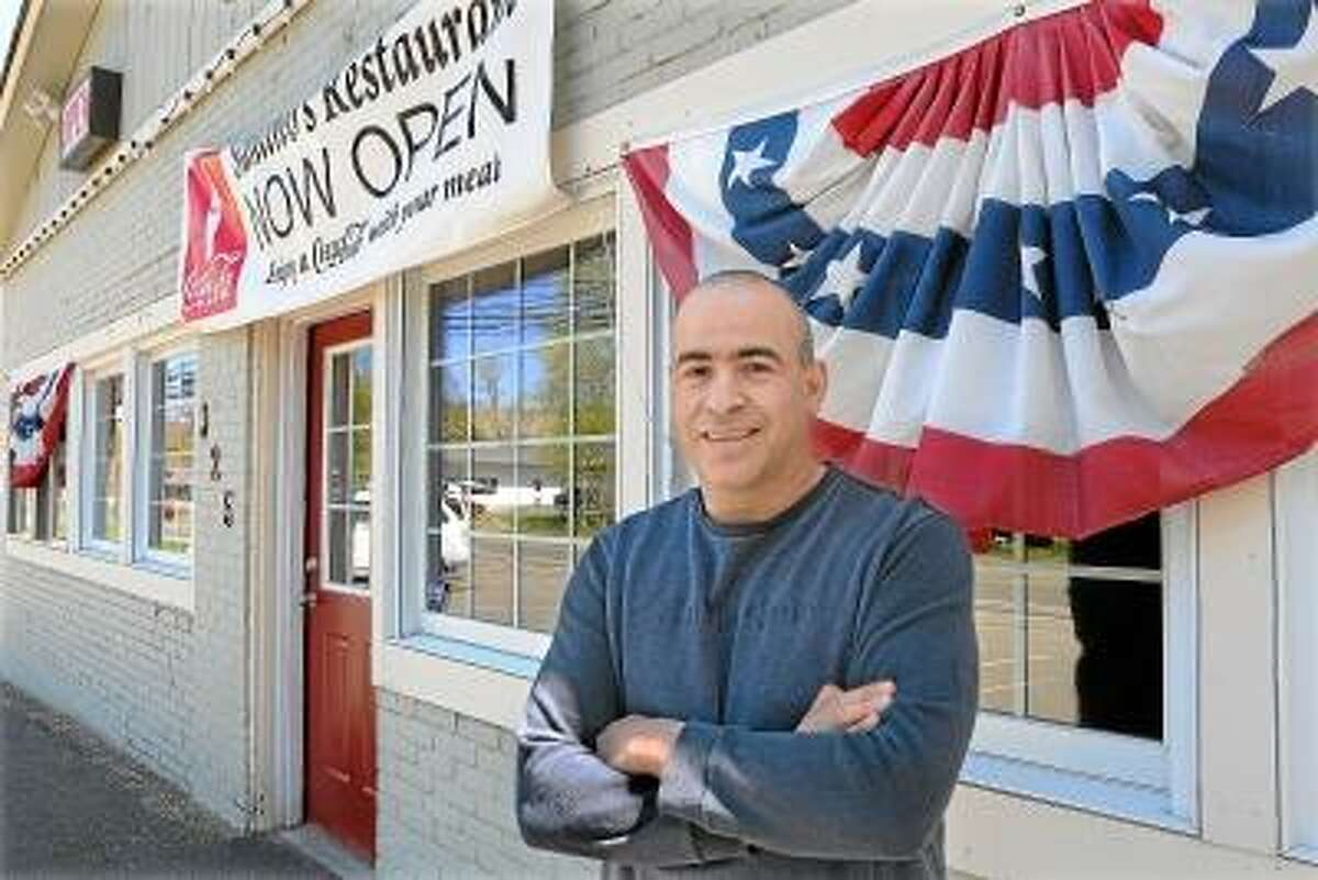 Catherine Avalone/The Middletown Press Sal Salafia, owner of Santino's Restaurant on Main Street in Durham.