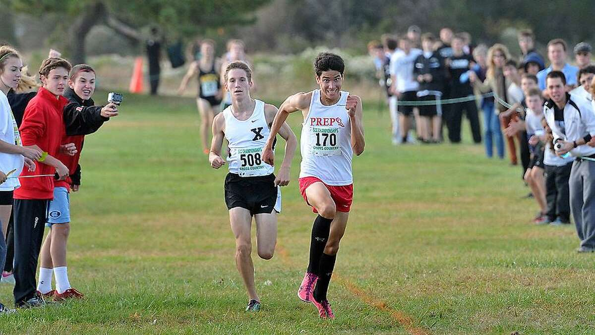 Madison-- The Varsity boys SCC Cross Country Championships. Fairfield Prep's Chris Alvarado gives a last kick to hold off Xavier's Mitchell Brown. Photo by Peter Casolino/New Haven Register 10/18/12