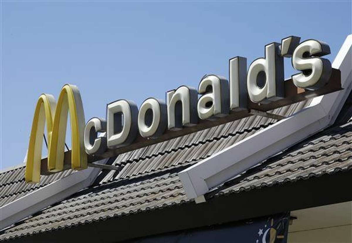 In this Friday, April 20, 2012, file photo, a McDonald's sign is shown at a McDonald's restaurant in East Palo Alto, Calif. McDonald's Corp., on Wednesday, Sept. 4, 2013, announced that a revamped version of its Dollar Menu that includes items priced at $5 could be launched nationally this year. (Paul Sakuma/AP/File) (Paul Sakuma)
