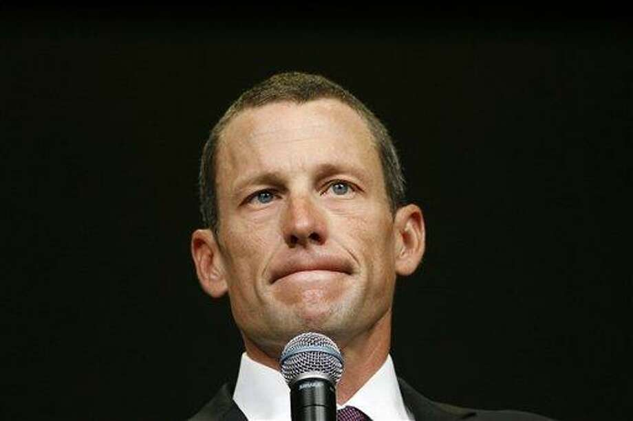Lance Armstrong during the 2009 opening session of the Livestrong Global Cancer Summit in Dublin, Ireland. Armstrong said Wednesday he is stepping down as chairman of his cancer-fighting charity so the group can focus on its mission instead of its founder's problems. Associated Press Photo: AP / AP