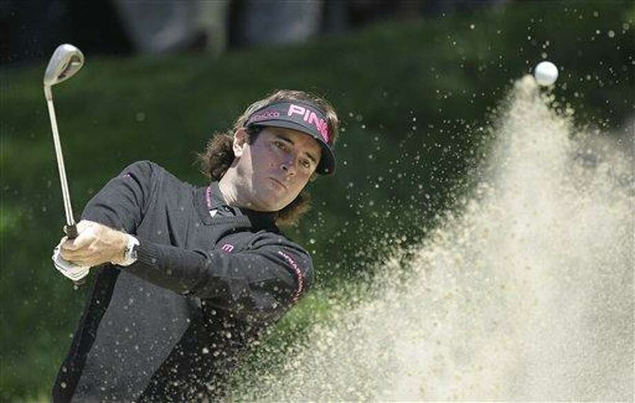 Bubba Watson hits out of a bunker on the second hole during the second round of the U.S. Open Championship golf tournament Friday, June 15, 2012, at The Olympic Club in San Francisco. (AP Photo/Ben Margot) Photo: AP / AP