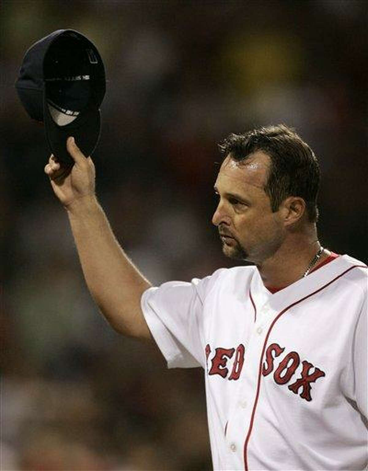 ** FILE ** Boston Red Sox starter Tim Wakefield tips his cap to the crowd while leaving in the seventh inning leading 2-1 against the Texas Rangers during their baseball game at Fenway Park in Boston, in this June 29, 2007 file photo. (AP Photo/Charles Krupa)