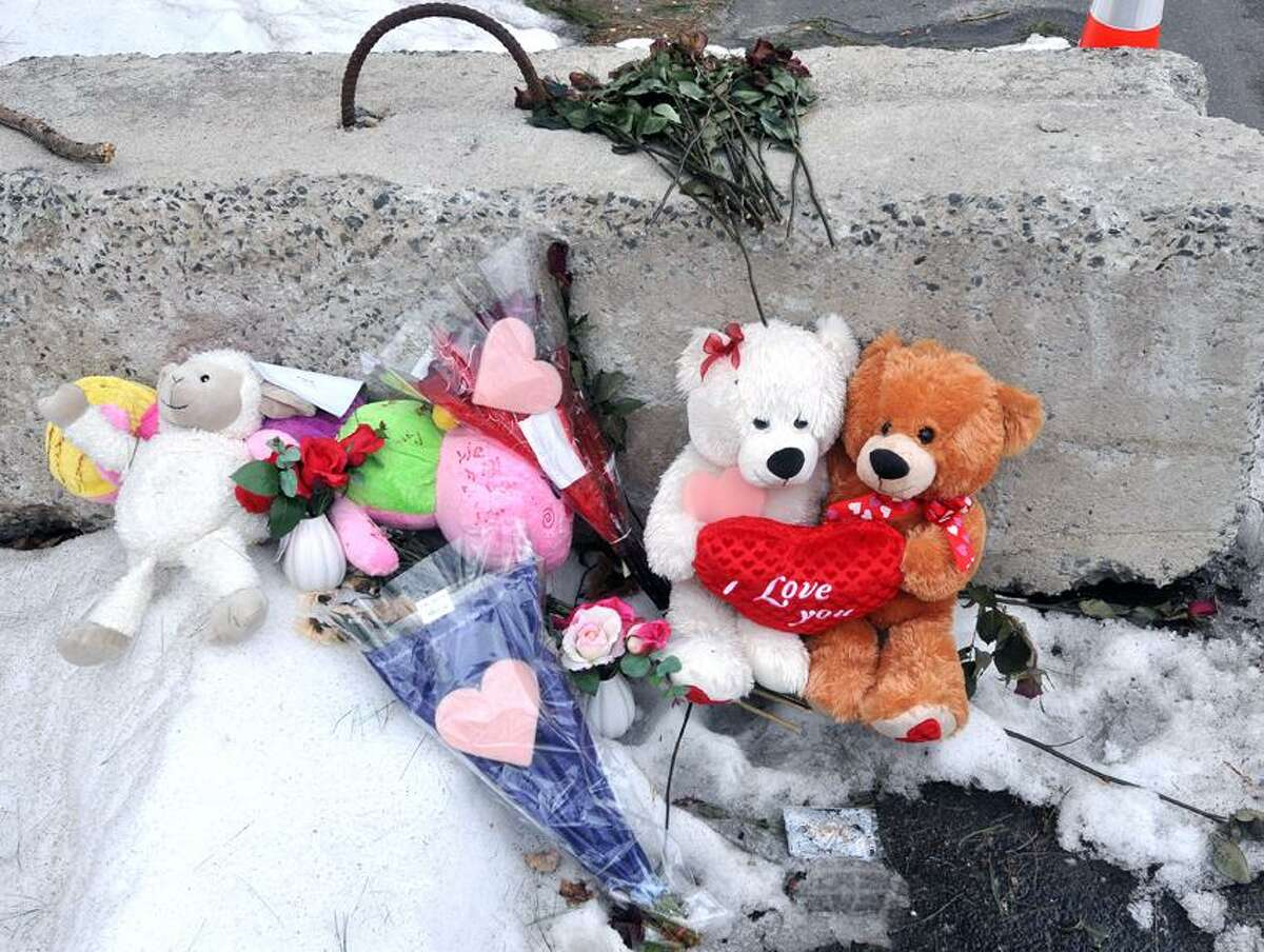 Sandy Hook-- Mementos left by mourners along the barricade at the entrance road to the Sandy Hook Elementary School . Photo-Peter Casolino 02/22/12