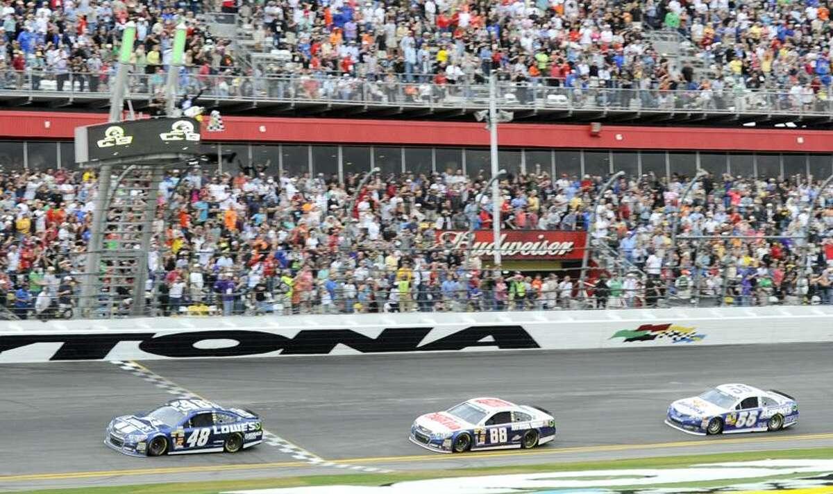 Feb 24, 2013; Daytona Beach, FL, USA; NASCAR Sprint Cup Series driver Jimmie Johnson (48) beats Dale Earnhardt Jr (88) and Mark Martin (55) to the finish line to win the 2013 Daytona 500 at Daytona International Speedway. Mandatory Credit: Kevin Liles-USA TODAY Sports