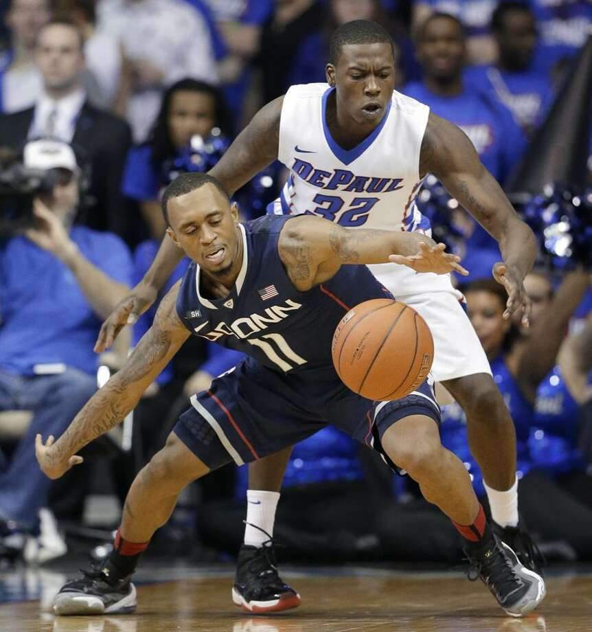 Connecticut guard Ryan Boatright (11) controls the ball against DePaul guard Charles McKinney (32) during the second half of an NCAA college basketball game in Rosemont, Ill., on Saturday, Feb. 23, 2013. Connecticut won 81-69. (AP Photo/Nam Y. Huh) Photo: AP / AP2013