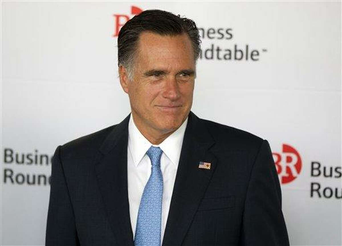Republican presidential candidate, former Massachusetts Gov. Mitt Romney waits as he is introduced during the Business Roundtable quarterly meeting Wednesday at the Newseum in Washington. Associated Press
