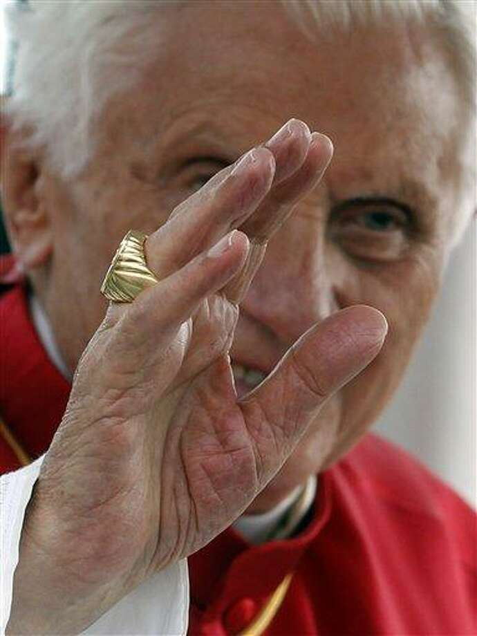 Pope Benedict XVI waves as he arrives to celebrate a Mass, in Bresso, near Milan, Italy, recently. Benedict has offered an ultratraditionalist splinter group a type of legal standing in the Catholic Church. Associated Press Photo: AP / AP