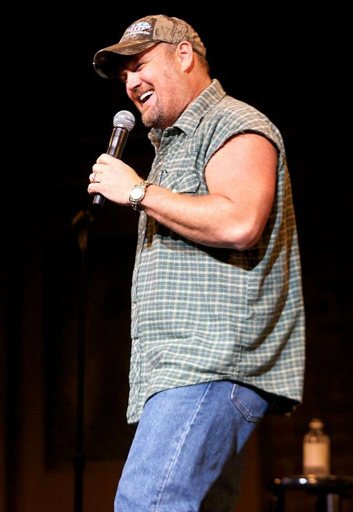 """Daniel Lawrence Whitney, better known by the stage name Larry the Cable Guy, is shown performing on stage during a sold out """"live"""" concert appearance."""