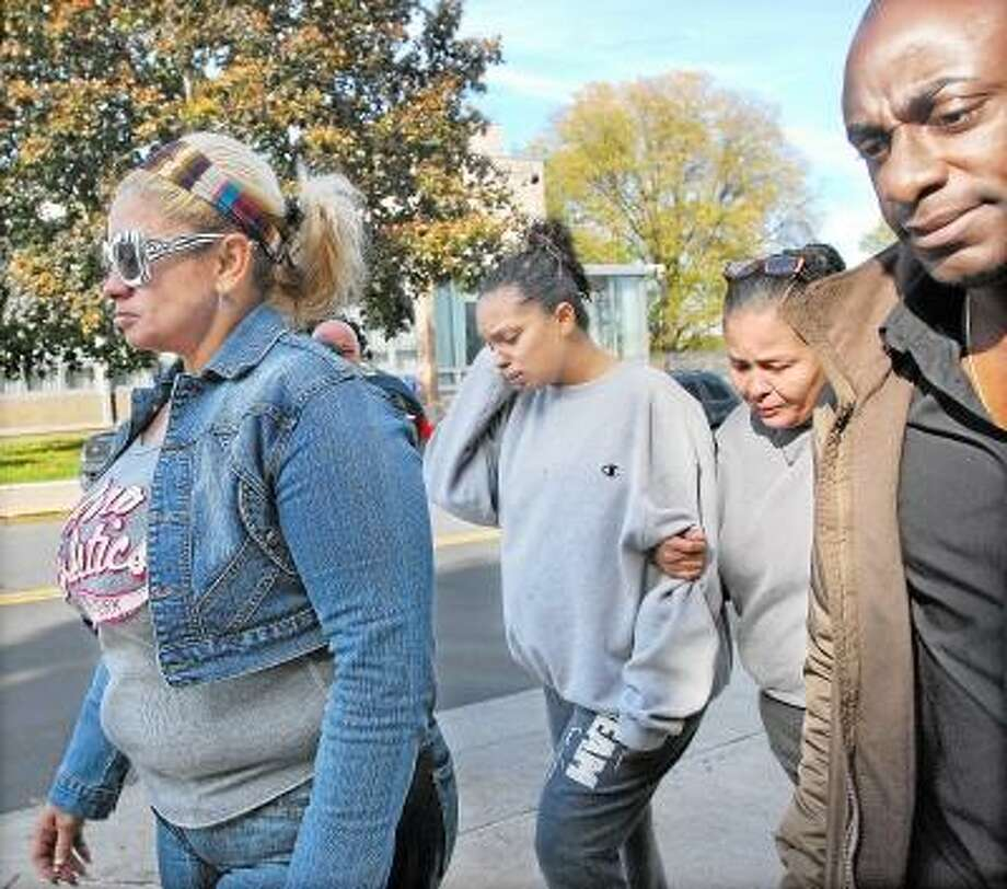 Supporters of Jose Gonzalez exit Middlesex Superior Court on Court Street in Middletown following his arraignment Wednesday afternoon. Gonzalez is charged in the early morning car chase from Meriden to Haddam involving various stolen cars. Gonzalez is being held on a $60,000 bond and is due back in court November 7. Catherine Avalone/The Middletown Press