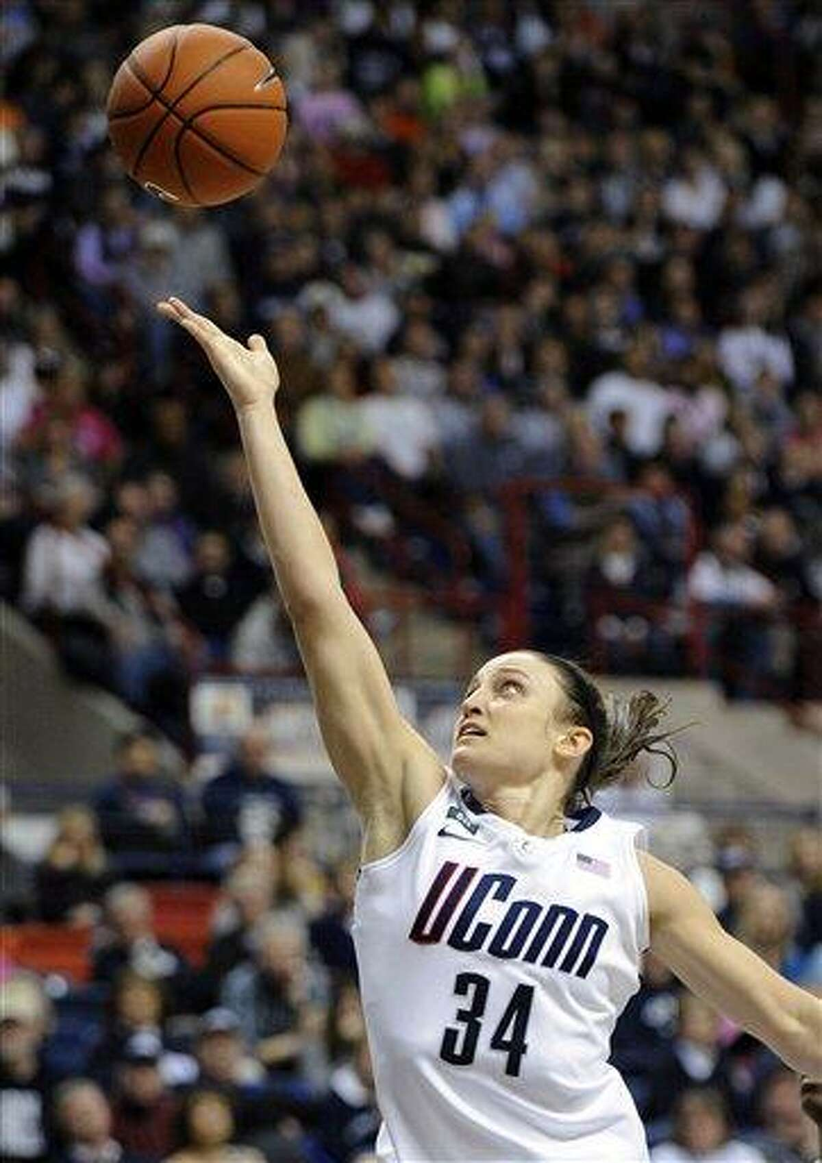 Connecticut's Kelly Faris scores her 1000th career point during the second half of her team's 90-30 victory over Seton Hall in an NCAA college basketball game in Storrs, Conn., Saturday, Feb. 23, 2013. Faris scored a game-high 18 points in the win. (AP Photo/Fred Beckham)