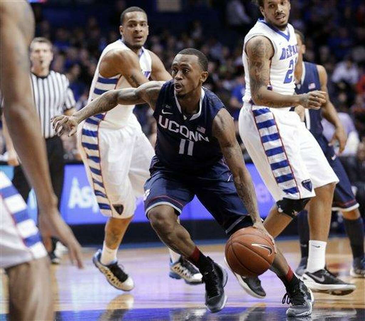Connecticut guard Ryan Boatright (11) drives to the basket during the first half of an NCAA college basketball game against DePaul in Rosemont, Ill., on Saturday, Feb. 23, 2013. (AP Photo/Nam Y. Huh)
