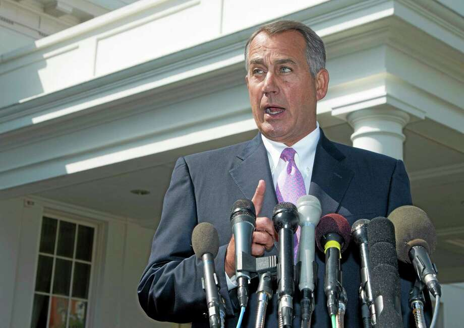 House Speaker John Boehner of Ohio speaks to reporters outside the White House in Washington, Tuesday, Sept. 3, 2013, following a meeting between President Barack Obama and Congressional leaders to discuss the situation in Syria. Boehner said he will support President Barack Obama's call for the U.S. to take action against Syria for alleged chemical weapons use and says his Republican colleagues should support the president, too.  (AP Photo/Manuel Balce Ceneta) Photo: AP / AP