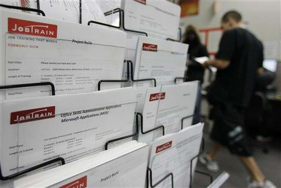 This Feb. 14 photo shows job postings at JobTrain employment center in Menlo Park, Calif. The number of people seeking unemployment benefits fell to the lowest point in almost four years last week, the latest signal that the job market is steadily improving. Associated Press Photo: AP / AP