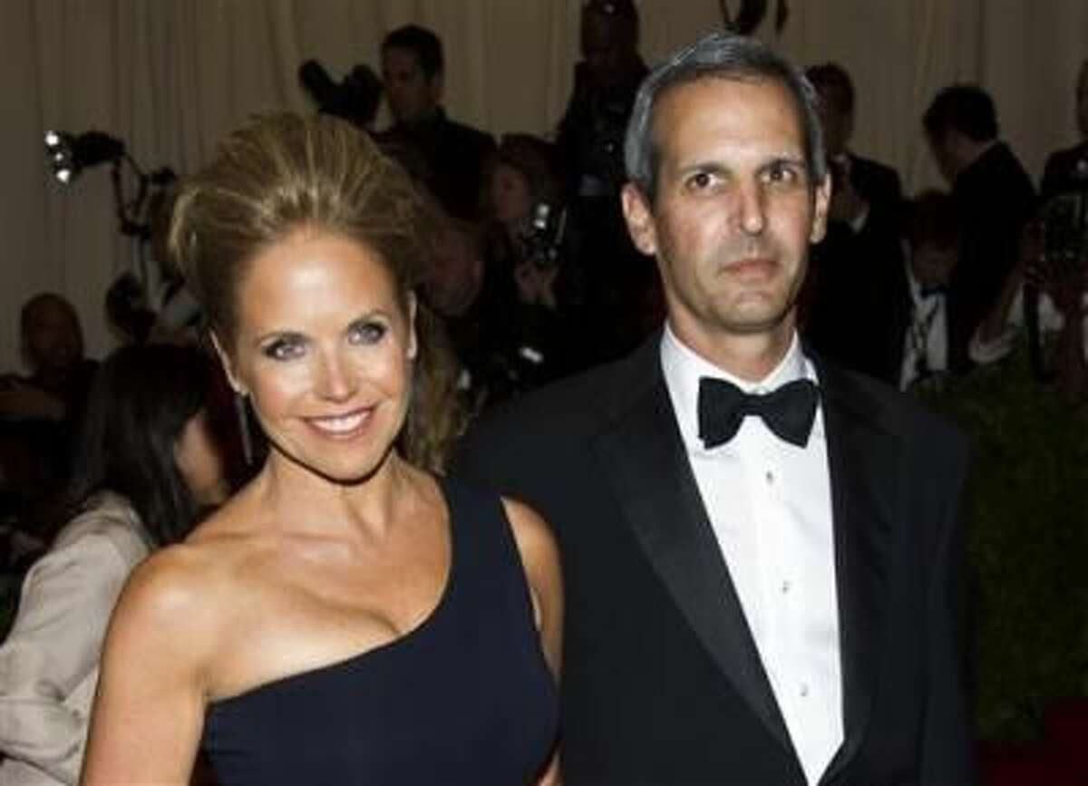 """FILE - In this May 6, 2013 file photo, TV personality Katie Couric, left, and John Molner attend The Metropolitan Museum of Art's Costume Institute benefit celebrating """"PUNK: Chaos to Couture"""" in New York. Couric is engaged to her financier boyfriend John Molner. Couric?s spokesman Matthew Hiltzik confirmed the engagement Tuesday morning following a report by People magazine. Molner gave 56-year-old Couric, the former host of ?Today,? a diamond ring over the weekend in East Hampton. (Photo by Charles Sykes/Invision/AP, File) (Charles Sykes)"""