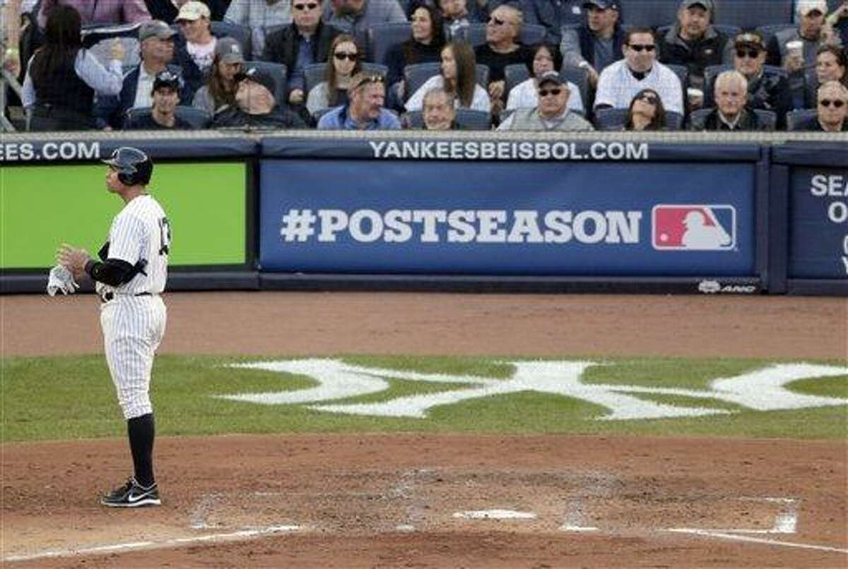 New York Yankees' Alex Rodriguez takes off his batting gloves after striking out in the fourth inning of Game 2 of the American League championship series against the Detroit Tigers Sunday, Oct. 14, 2012, in New York. (AP Photo/Charlie Riedel)