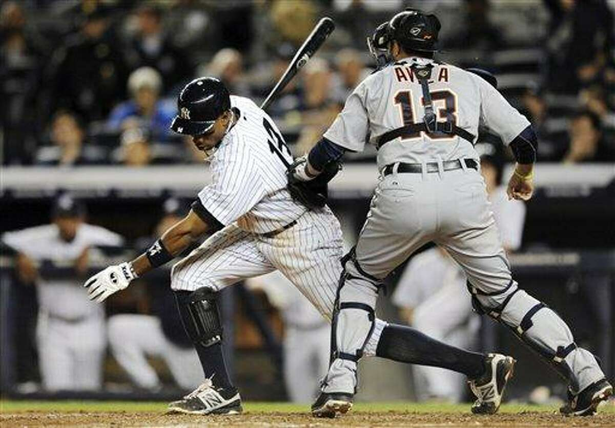 New York Yankees' Curtis Granderson strikes out swinging for the final out of their 3-0 loss to the Detroit Tigers in Game 2 of baseball's American League championship series, Sunday, Oct. 14, 2012, in New York. (AP Photo/The Record of Bergen County, Tyson Trish) ONLINE OUT; MAGS OUT; TV OUT; INTERNET OUT; NO ARCHIVING; MANDATORY CREDIT