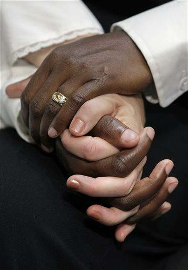 FILE - In this Wednesday, July 20, 2011 file photo, Suzanne Artis and Geraldine Artis of Clinton, Conn., hold hands as they attend a Senate Judiciary Committee hearing on Capitol Hill in Washington to assess the impact of the Defense of Marriage Act. The Supreme Court is expected to rule by late June 2013 in two cases involving same-sex marriage. One is a challenge to California's voter-approved Proposition 8 that defines marriage as the union of a man and a woman. The other seeks to strike down a portion of the federal Defense of Marriage Act that denies to legally married same-sex couples a range of benefits that generally are available to married heterosexuals. (AP Photo/J. Scott Applewhite) Photo: AP / AP