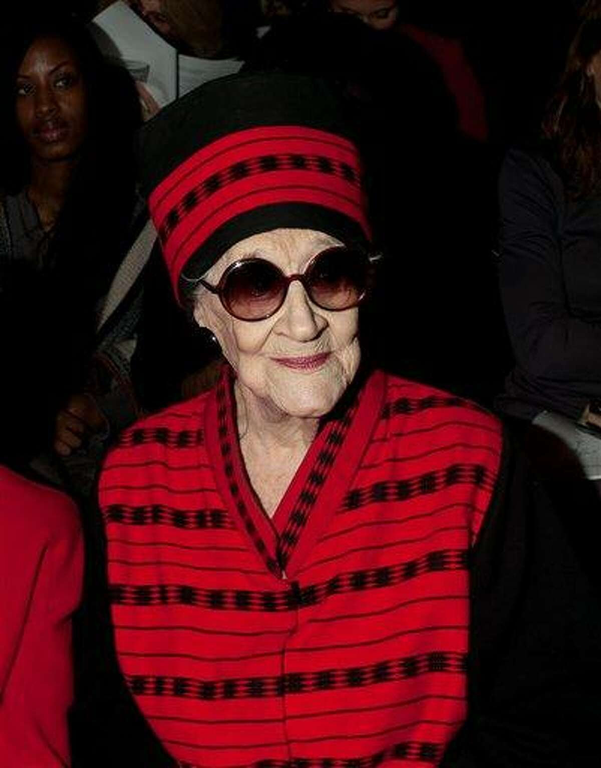 Zelda Kaplan, 95, waits for the Joanna Mastroianni Fall 2012 fashion show to begin, during Fashion Week, Wednesday in New York. Kaplan was sitting in the front row of designer Mastroianni's show at Lincoln Center when she collapsed. She was later pronounced dead at Roosevelt Hospital. Kaplan was known for her lively nightlife, attending art openings, parties and clubs with people young enough to be her great-grandchildren. Associated Press
