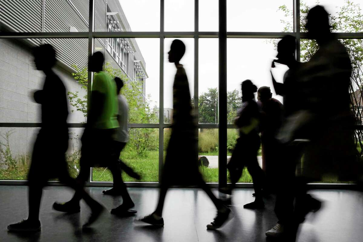 In this Aug. 29, 2013 photo, students walk the halls during an open house for incoming freshman and transfer students at Kensington High School for the Creative and Performing Arts in Philadelphia. (AP Photo/Matt Slocum)