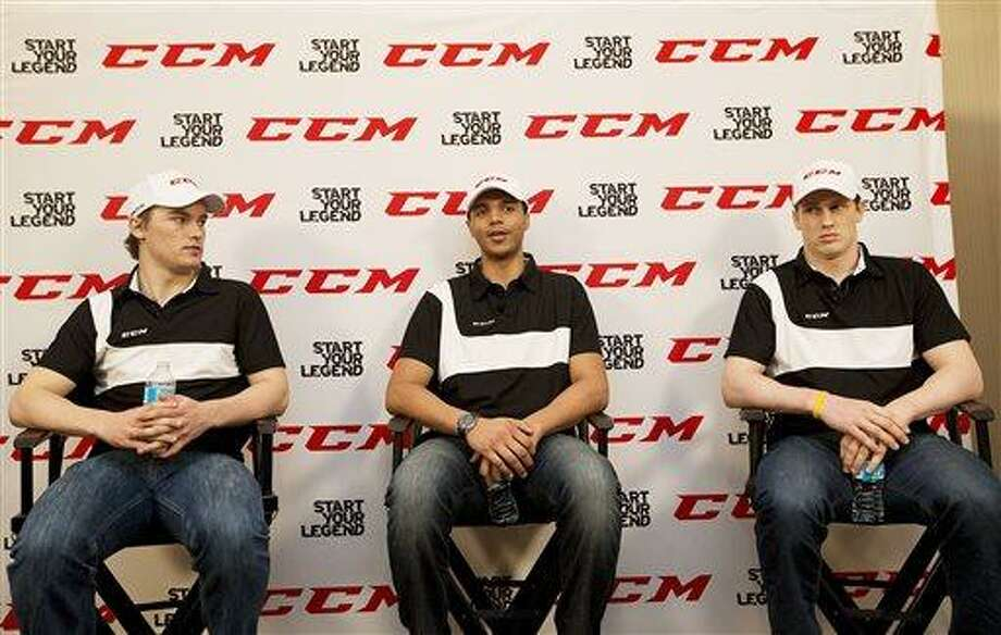 FILE - In this May 30, 2013, file photo, NHL draft prospects, from left, Jonathan Drouin, Seth Jones, and Nathan MacKinnon answer questions at a news conference in Mississauga, Ontario. The Colorado Avalanche will likely choose among MacKinnon, Jones and Drouin when they have the first pick in Sunday's NHL draft at the Prudential Center in Newark, N.J. (AP Photo/The Canadian Press, Michelle Siu, File) Photo: AP / CP