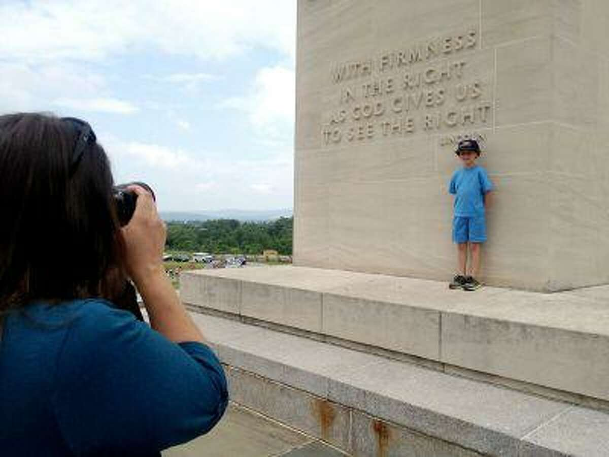 Ellen Stewart, of Blackwood, N.J., photographs her son, Johnny, 8, at the Eternal Light Peace Memorial on Friday. Stewart and her husband, John, brought Johnny to Gettysburg for his birthday gift.
