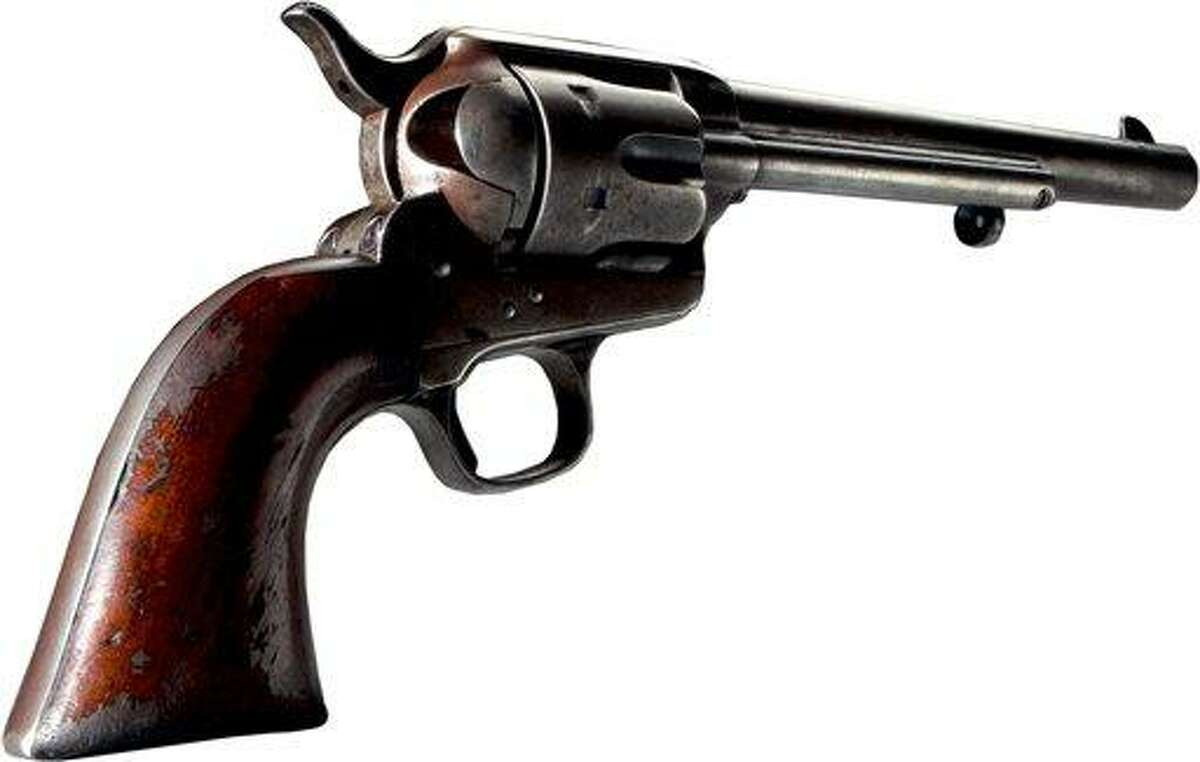 FILE - This undated file photo provided by the Texas State Historical Association shows a Colt Single Action Army Revolver dated to 1881. It was made in Connecticut. (AP Photo/Texas State Historical Association via the Dallas Morning News)