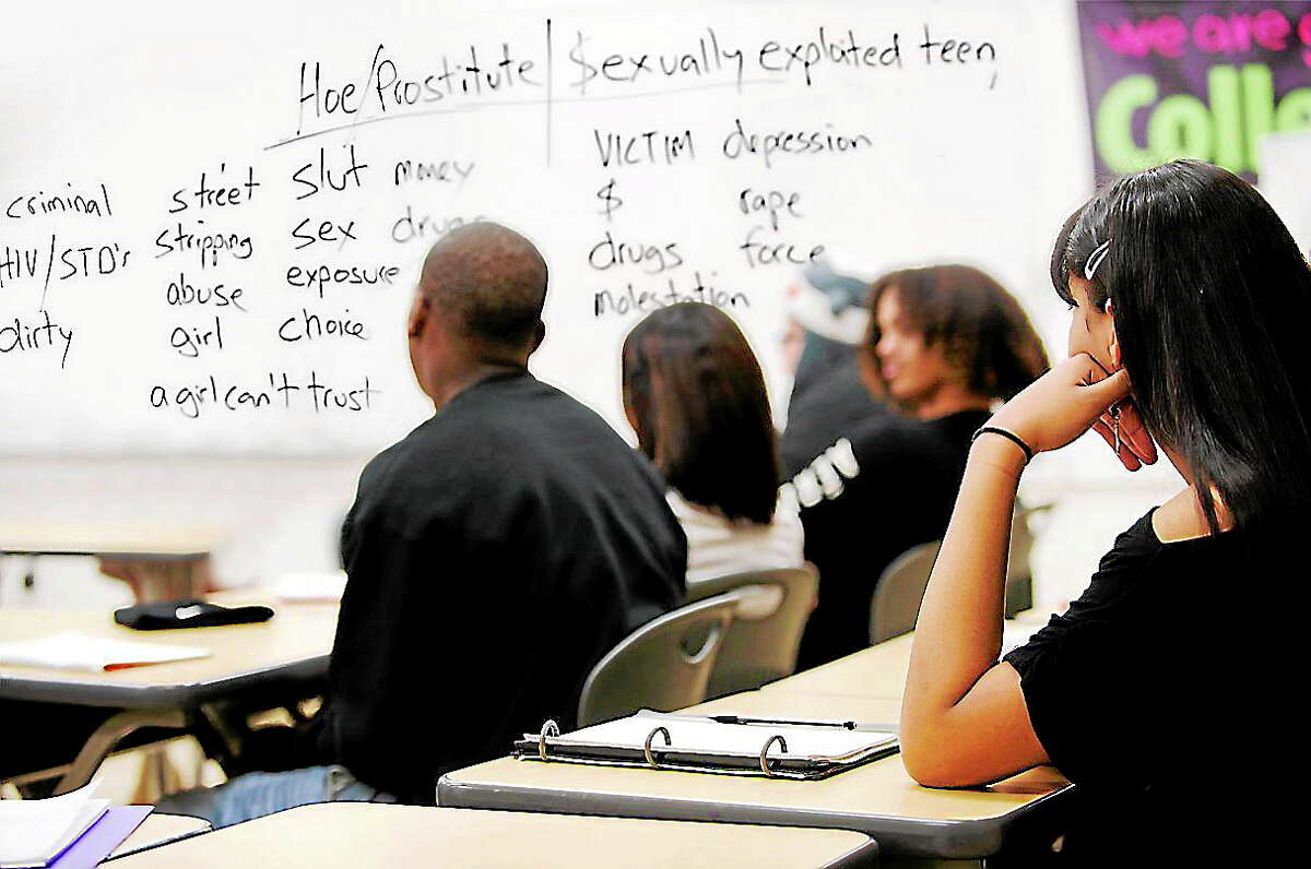 A Love 146 training program in session, with words on the board for discussion.