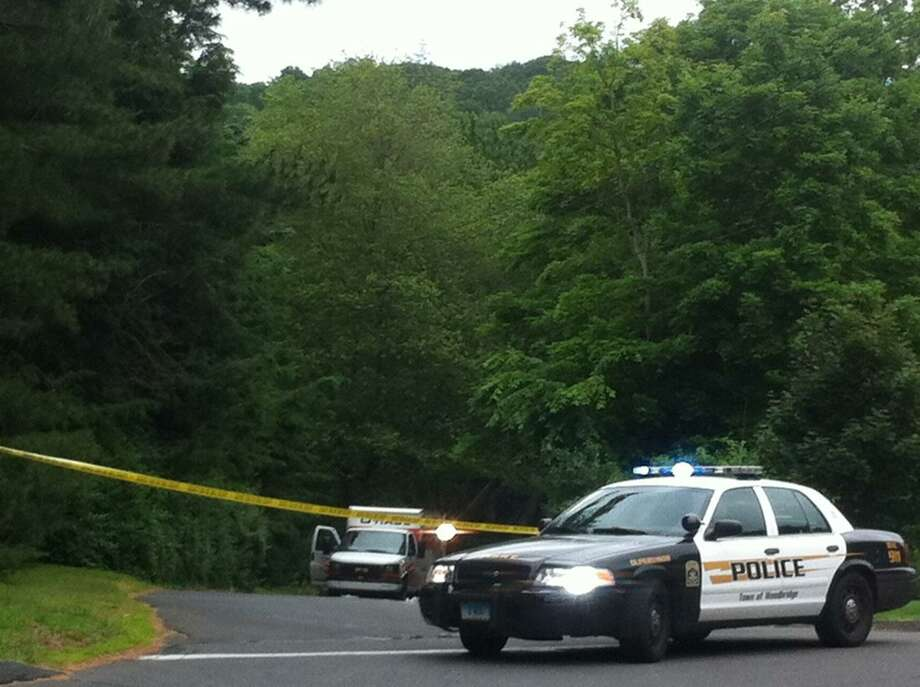 Police block section of road where rental truck with body was found. William Kaempffer/For the New Haven Register