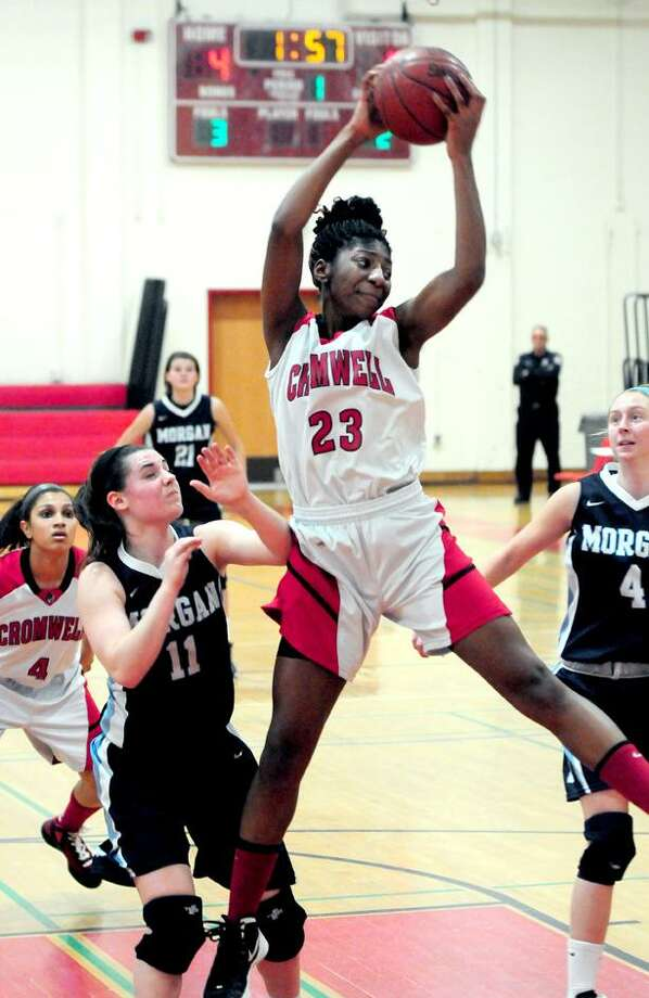 Janelle Harrison of Cromwell pulls down a rebound in the first half of the Shoreline Conference Championship against Morgan in New Haven on 2/22/2013.Photo by Arnold Gold/New Haven Register