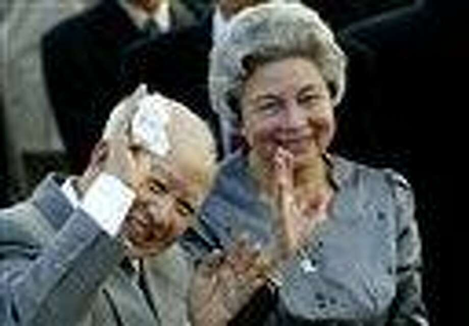 Former King Norodom Sihanouk and Queen Monineath wave at Phnom Penh airport, in Cambodia. Sihanouk, who was never far from the center of his country's politics through a half-century of war, genocide and upheaval, died of natural causes early Monday. AP Photo Photo: AP / AP