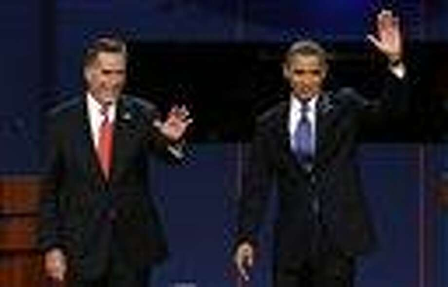 Republican presidential candidate Mitt Romney and President Barack Obama wave to the audience during the first presidential debate at the University of Denver in Denver. AP PHOTO Photo: AP / AP