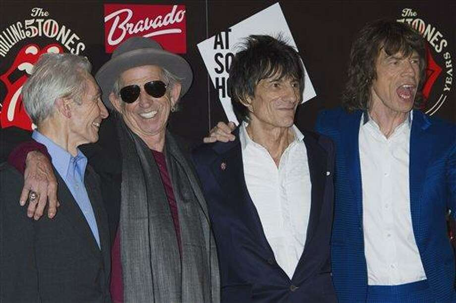 This Thursday, July 12, 2012 file photo shows, from left, Charlie Watts, Keith Richards, Ronnie Wood and Mick Jagger, from the British Rock band, The Rolling Stones, as they arrive at a central London venue, to mark the 50th anniversary of the Rolling Stones first performance. The legendary band said Monday it would return to the stage this year with four concerts in New York and London. The shows mark the first time in five years at the Stones have performed live, with Mick Jagger, Keith Richards, Charlie Watts and Ronnie Wood all coming together once more. (AP Photo/Jonathan Short) Photo: AP / AP