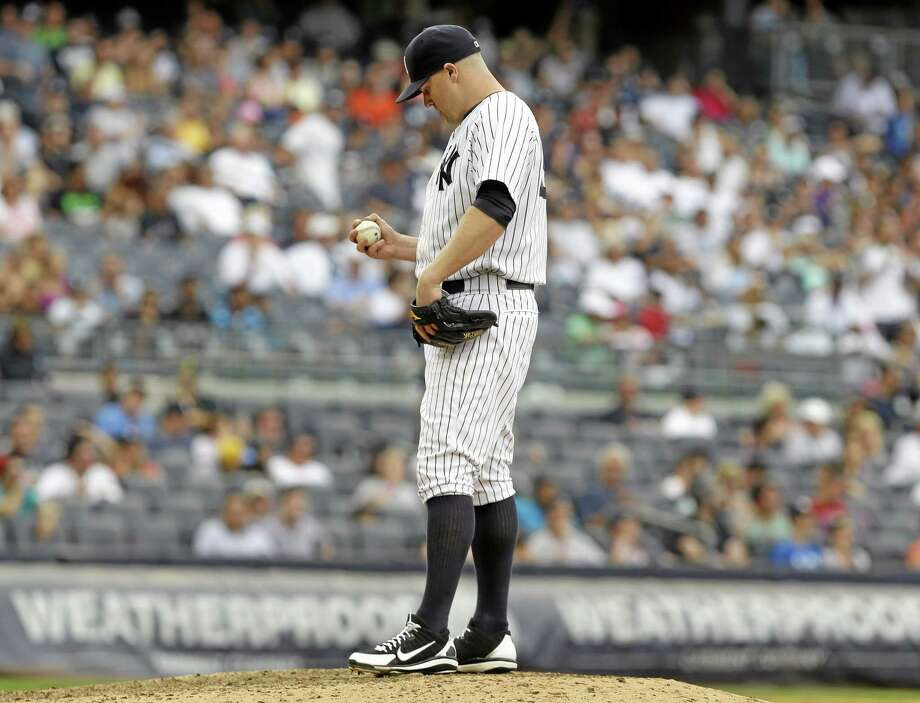 Yankees reliever Shawn Kelley reacts after giving up a three-run home run during the seventh inning Sunday. Photo: Seth Wenig — The Associated Press  / AP