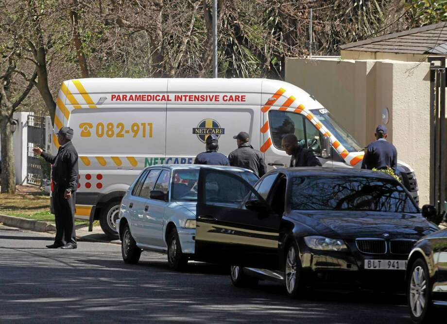 An ambulance transporting former South African president Nelson Mandela arrives at the home of the former statesman in Johannesburg, South Africa, Sunday, Sept. 1, 2013. Mandela has been in hospital for more than two months fighting a recurring lung infection. (AP Photo / Denis Farrell) Photo: AP / AP