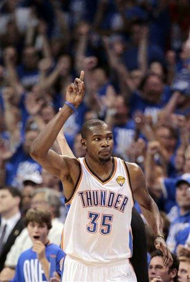 Oklahoma City Thunder small forward Kevin Durant (35) gestures as he goes down court against the Miami Heat during the second half at Game 1 of the NBA finals basketball series, Tuesday, June 12, 2012, in Oklahoma City. The Thunder won 105-94.(AP Photo/Jeff Roberson) Photo: AP / AP