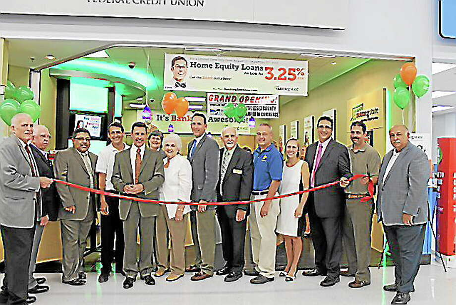 Nutmeg Photo: Chamber President Larry McHugh, State Senator Paul Doyle, Cromwell First Selectwoman Mertie Terry, Chamber Chairwoman Darlene Briggs, Cromwell Police Chief Anthony Salvatore and Cromwell Division Chairman Mike Cornett help the Nutmeg State Federal Credit Union team celebrate their Grand Opening on Wednesday, August 28, 2013. Photo: Journal Register Co.