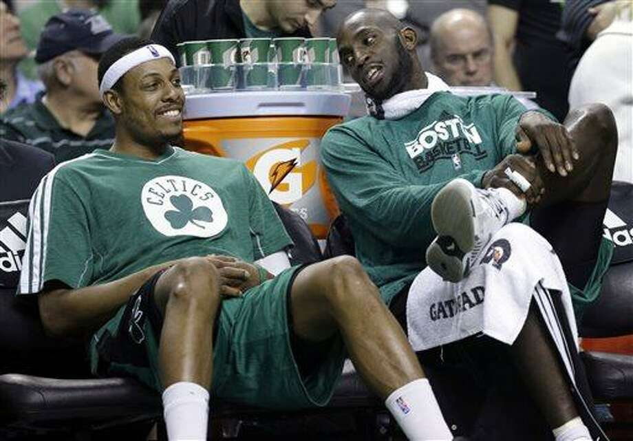 FILE - Boston Celtics center Kevin Garnett, right, chats with teammate Paul Pierce on the bench during the fourth quarter of an NBA basketball game against the Toronto Raptors in Boston, in this March 13, 2013 file photo. The Brooklyn Nets will acquire Paul Pierce and Kevin Garnett from the Boston Celtics in a deal that was still developing as the NBA draft ended, according to a person with knowledge of the details. The trade can't be completed until July 10, after next season's salary cap is set, so pieces were still being discussed early Friday June 28, 2013.  (AP Photo/Elise Amendola, File) Photo: AP / AP