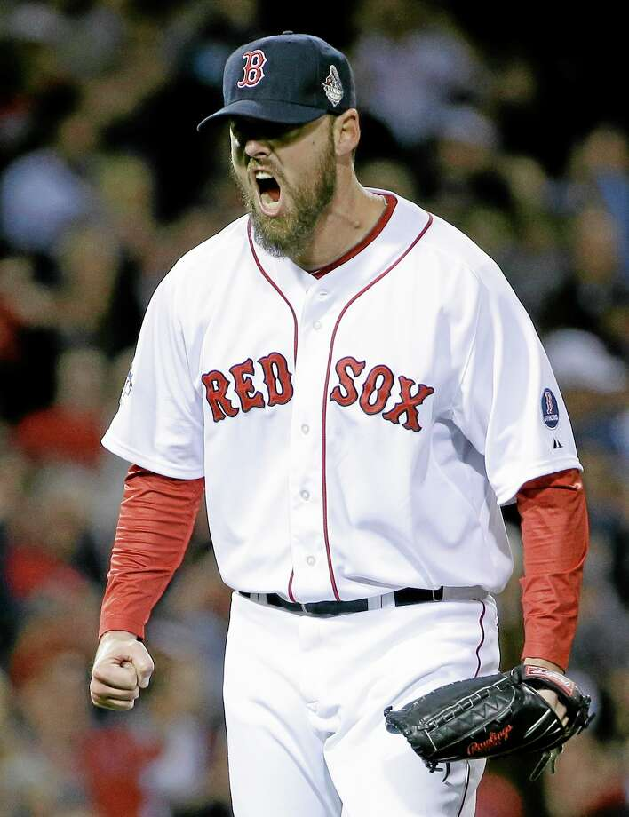 Red Sox starting pitcher John Lackey reacts after getting the Cardinals' Jon Jay to strike out and end the top of the second inning of Game 6 of the World Series on Wednesday at Fenway Park in Boston. Photo: David J. Phillip — The Associated Press  / AP