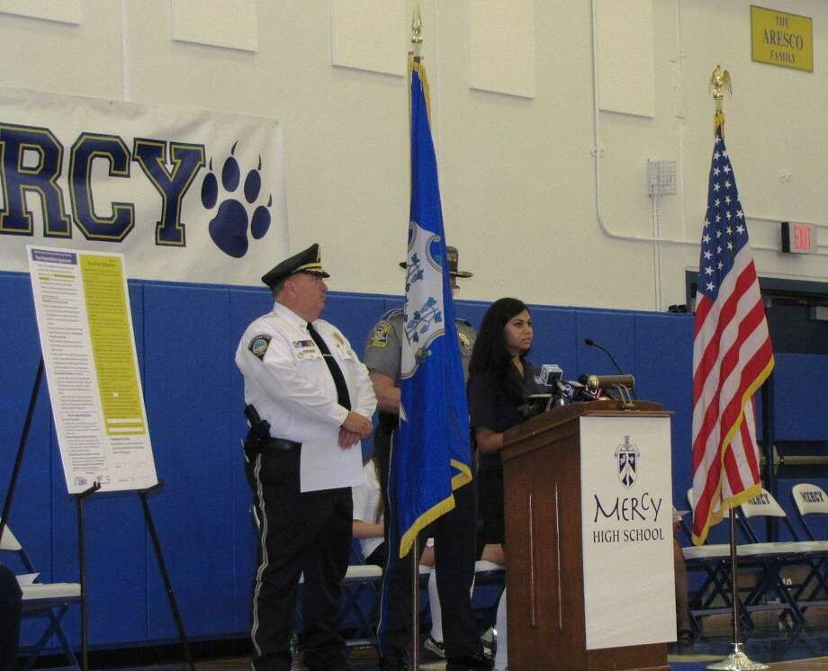 Southington Police Chief John Daly, head of the Connecticut Police Chief's Association, was among the speakers at the Safe Driving Event at Mercy High School. Student Juhi Gupta is at the podium.