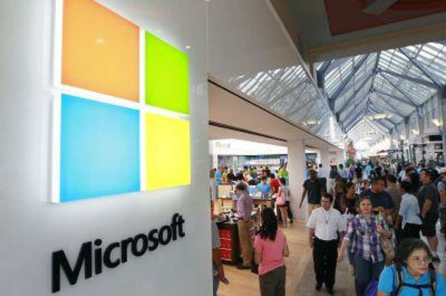 In this Thursday, Aug. 23, 2012 file photo, the Microsoft Corp. logo, left, is seen on an exterior wall of a new Microsoft store inside the Prudential Center mall, in Boston. Microsoft will use its annual developers conference to release a preview of Windows 8.1, a free update that promises to address some of the gripes people have with the latest version of the company's flagship operating system. The Build conference, which starts Wednesday, June 26, 2013, in San Francisco, will give Microsoft's partners and other technology developers a chance to try out the new system before it becomes available to the general public later in the year. (AP Photo/Steven Senne, File) Photo: AP / AP