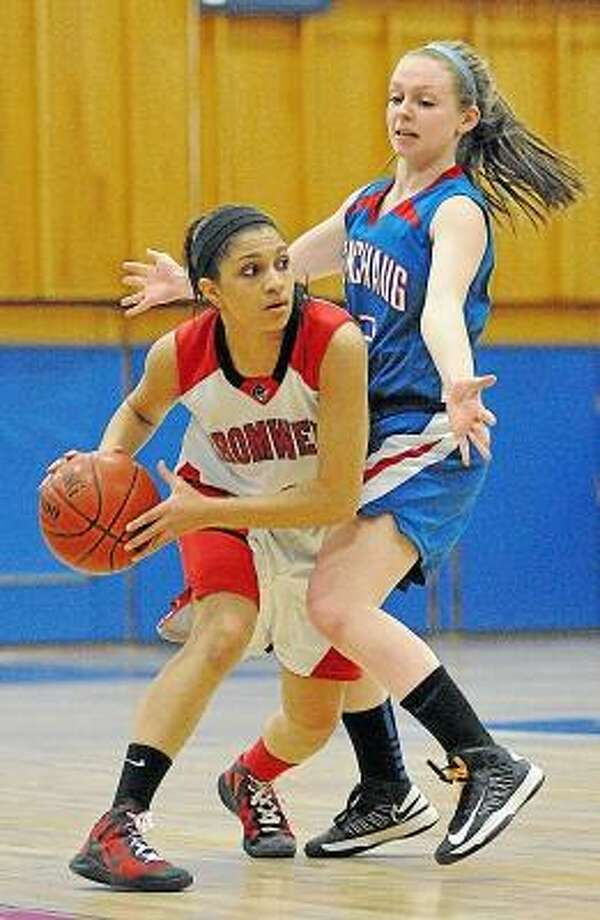 Cromwell senior guard Alexa Riley plays looks to make a pass against Coginchaug sophomore Audrey Arcari Thursday night at the Shoreline Conference Semi-Final tournament game at Coginchaug High School. The Cromwell Panthers defeated the Coginchaug Blue Devils 39-34. Photo by Catherine Avalone/The Middletown Press / TheMiddletownPress