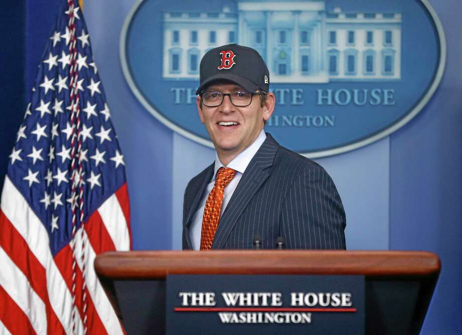White House press secretary Jay Carney, wearing a Red Sox cap, arrives for the daily press briefing at the White House in Washington. Photo: Charles Dharapak — The Associated Press  / AP