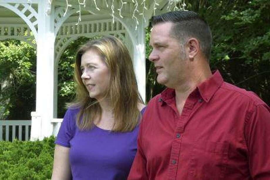 Melanie and Matt Capobianco talk to reporters in their suburban neighborhood near Charleston, S.C., on June 25, 2013. Photo: Reuters / X80002