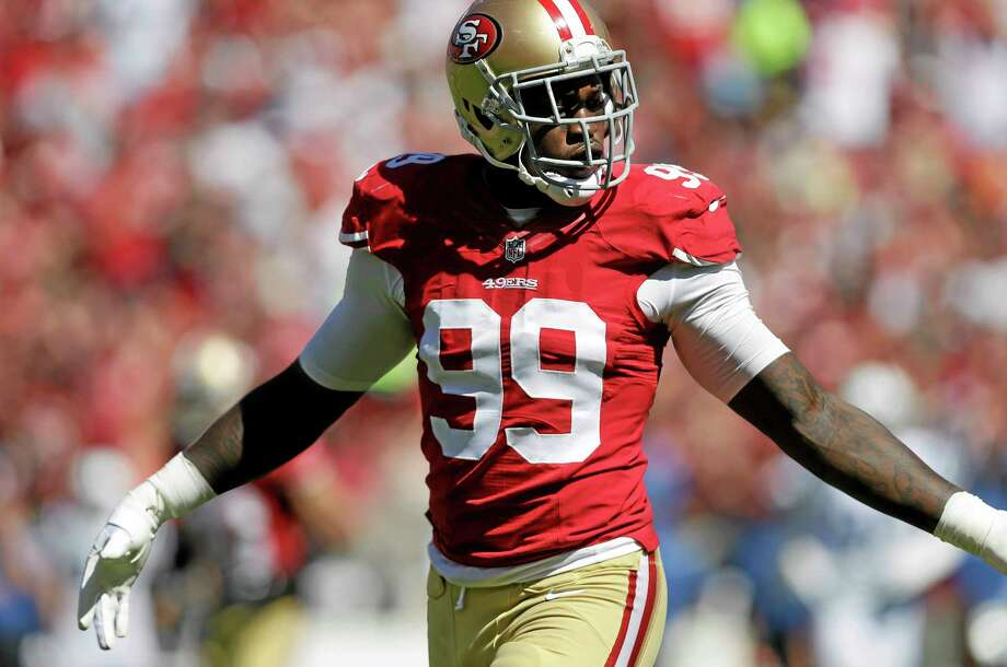 San Francisco 49ers linebacker Aldon Smith was activated to the roster on Thursday from the non-football injury list, two days after he turned himself in to Santa Clara County authorities as he faces weapons charges. Photo: Marcio Jose Sanchez — The Associated Press  / AP