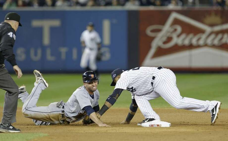 Detroit Tigers' Omar Infante dives back into second as New York Yankees' Robinson Cano reaches to tag him in the eighth inning of Game 2 of the American League championship series Sunday, Oct. 14, 2012, in New York. Infante was called safe on the play by umpire Jeff Nelson. (AP Photo/Paul Sancya ) Photo: AP / AP2012